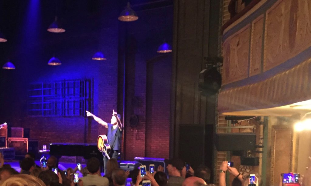 Springsteen stands on a Broadway stage and points to the crowd after the show.